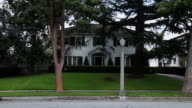 WS White colonial house with black shutters and street light in front / Hooker, OK, United State