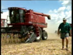 White farmer oversees wheat production on his land 1990s