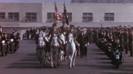 TS White horses drawing the caisson holding President Roosevelt's flagdraped casket and military escort leaving Union Station / Washington DC United...