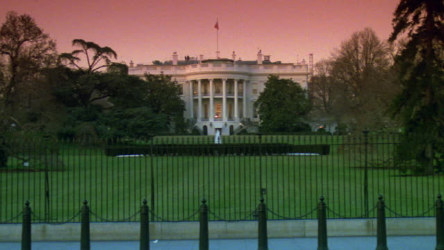 MS White house from north lawn with few lights and fountain / Washington D.C., United States