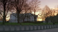 MS White house from north lawn with pedestrians walking / Washington D.C., United States
