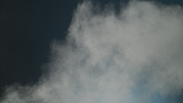 White powder being thrown and forming like a sea wave