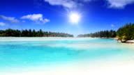 White sand beach and lagoon at tropical island