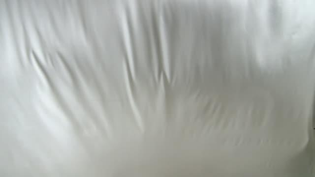 CU, White sheet blowing