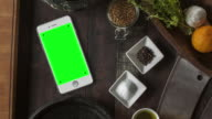White Smartphone on Desk Chroma Key Green Screen