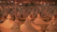 White tents crowd a campsite at Mecca.