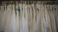 White wedding dresses are seen on October 11 2016 in London England It's a Chinese custom for couples to have their wedding photos taken before they...