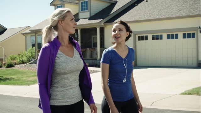White Women Walk in a Neighborhood
