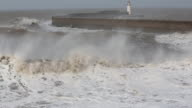 Whitehaven harbour and sea cliffs during the January 2014 period of storm surge, high tides and storm force winds. The coastline took a battering, damaging the harbour wall and eroding a large section of coastal cliff.