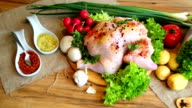 Whole raw chicken with vegetables and kitchen scales
