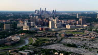 Wide aerial approach toward downtown Houston, over townhouses and parking. Shot in 2007.