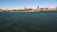 Wide aerial shot soaring over Chicago Harbor toward Adler Planetarium
