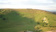 4K wide aerial track past Long Man
