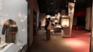 Wide angle at the Atomic Bomb Museum Nagasaki several visitors strolling and looking at the showcases