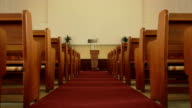 Wide angle push-in of church pews and pulpit