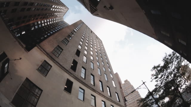 Wide Angle POV shot looking up at skyscrapers during a summer afternoon