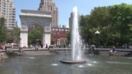 Wide Angle shot of the Washington Square Park Arch with the water fountain in the foreground on a hot summer day in NYC