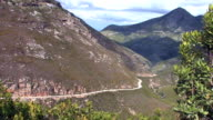 Wide angle view of road winding around a hill, Western Cape Province, South Africa