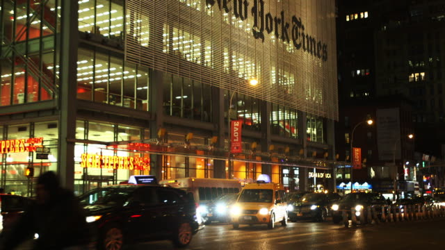 Wide establishing tilt up of the New York Times building Tilt up from traffic 620 Eight Avenue in New York City