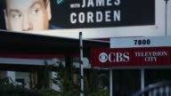 Wide exterior footage of signage and CBS Television City a television studio complex located in the Fairfax District of Los Angeles CA on August 3...