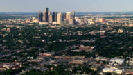 Wide flight over outlying areas past distant downtown Houston. Shot in 2007.