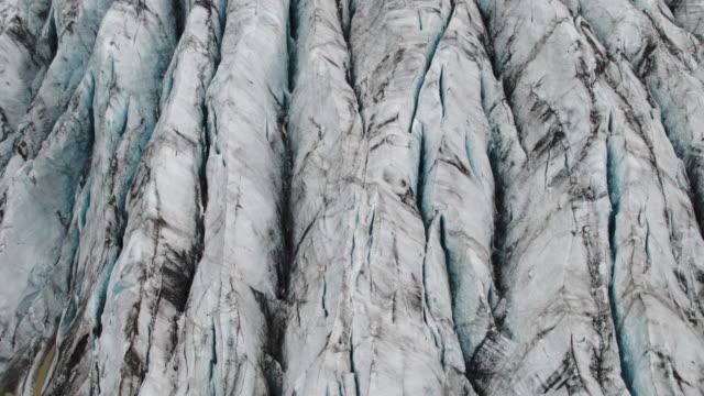 Wide flyover shot of ice on glacier / Iceland