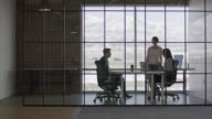 'Wide panning shot of business people in busy office / Lehi, Utah, United States'