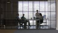 'Wide panning shot of business people talking in meeting / Lehi, Utah, United States'