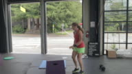 Wide profile. Jean Anne performs series of box jumps.