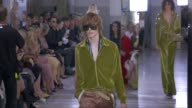 Wide runway shots highlights of looks with finale and designer