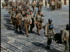 1944 wide shot 101st Airborne Division soldiers in uniform marching right before DDay / England