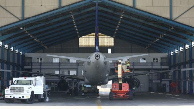 Wide shot a Cyprus Airways Public Ltd logo sits on display above the companys maintenance hangar at Larnaca international airport in Larnaca Cyprus...
