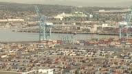 Wide Shot aerial push-in push-out tracking-left - Shipping containers fill the Long Beach port. / Los Angeles, California, USA