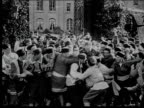 1916 B/W Wide shot angry mob dragging military officer from castle