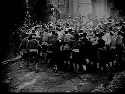 1916 B/W Wide shot angry mob storming castle