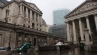 Wide shot Bank junction showing Bank of England headquarters on Threadneedle Street and the Royal Exchange Bank of England building viewed from steps...
