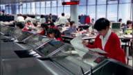 Wide shot bank tellers working / Hong Kong