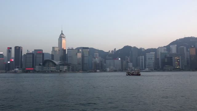 Wide shot Buildings stand in Hong Kong China on Thursday Jan 29 2015 Medium shot The Hong Kong Convention and Exhibition Centre left stands among...