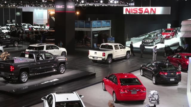 Wide Shot Cars and trucks are displayed at the North American International Auto Show on January 14 2014 in Detroit Michigan The auto show opens to...