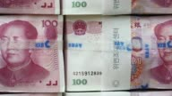 Wide shot Chinese onehundred yuan banknotes sit stacked at the Korea Exchange Bank headquarters in Seoul South Korea Close shot Chinese onehundred...