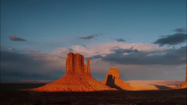 Wide shot clouds passing over The Mittens of Monument Valley / Navajo Reservation, Southwest USA