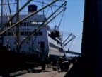 1939 Wide shot containers being loaded onto cargo ship/ San Francisco, California