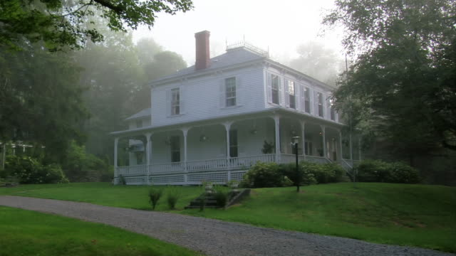 Wide shot country house in fog/ Roxbury, New York