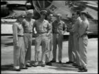 1945 wide shot crew of Enola Gay with Captain William Parsons Colonel Paul Tibbets Major Thomas Ferebee