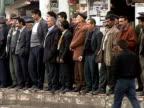 Wide shot Crowd of men watching along sidewalk/ Cizre Mardin Province Turkey