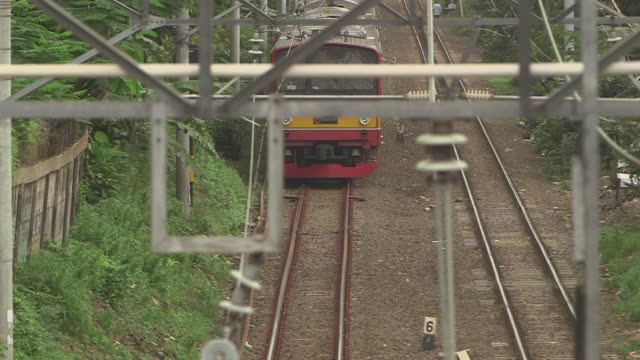 Wide shot elevated view of railway tracks and power lines in Central Jakarta Indonesia on Friday Feb 2 Wide shot elevated view of a man walking...