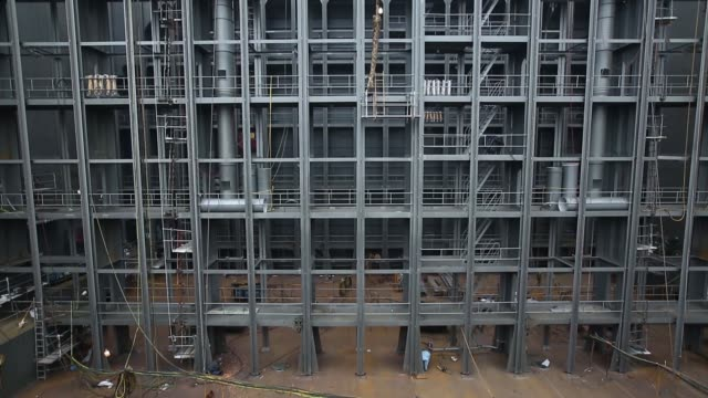 wide shot employees work on a ship under construction wide shot employees work on a ship under construction wide shot and tilt up employees work on a...