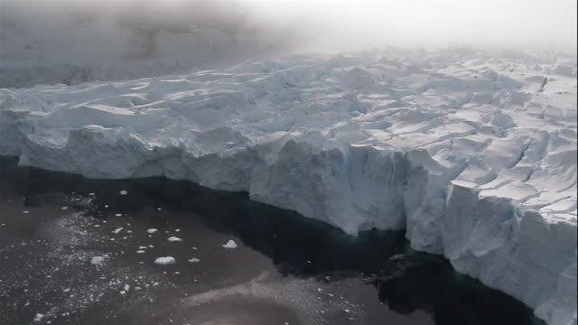 Wide shot Fog forming over glacier in Antarctic Sea/ Antarctica