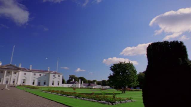 wide shot PAN from road + grounds to Aras an Uachtarain (President's Residence) / Dublin, Ireland