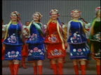 1967 wide shot group of Russian folk dancers performing / Russia